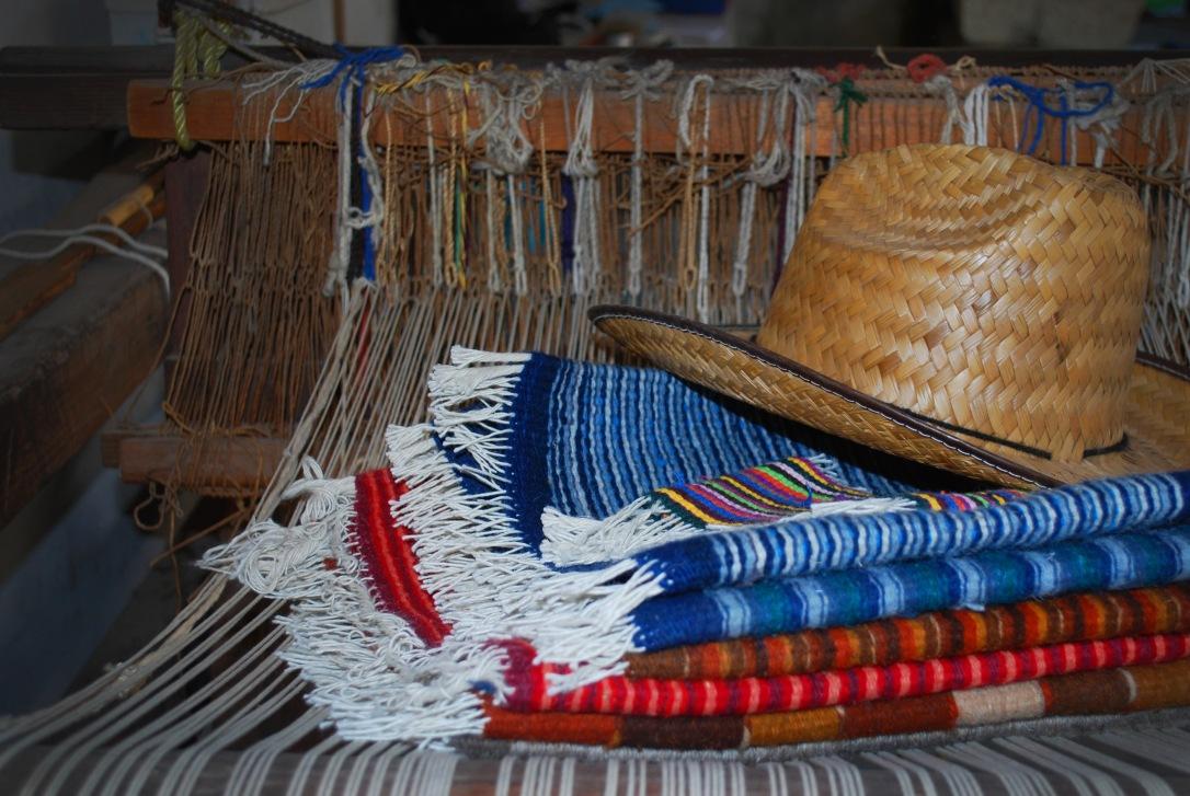 A loom and rugs woven by hand by a Fundación En Vía borrower in Teotitlán del Valle.