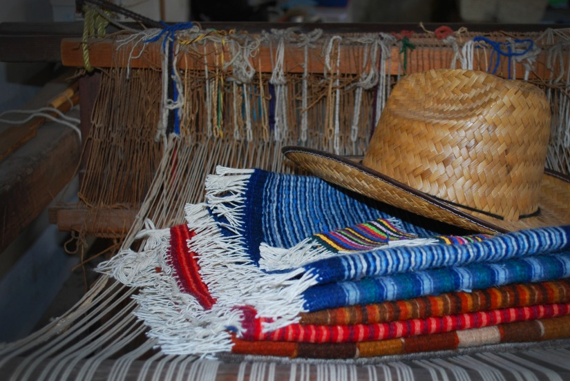 A loom and rugs woven by hand by a Fundación En Vía borrower in Teotitlán del Valle.