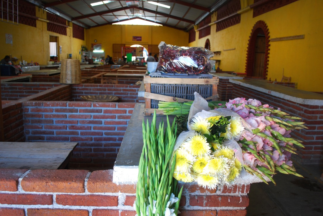 Market stalls in Teotitlán del Valle include everything from flower sellers to produce.