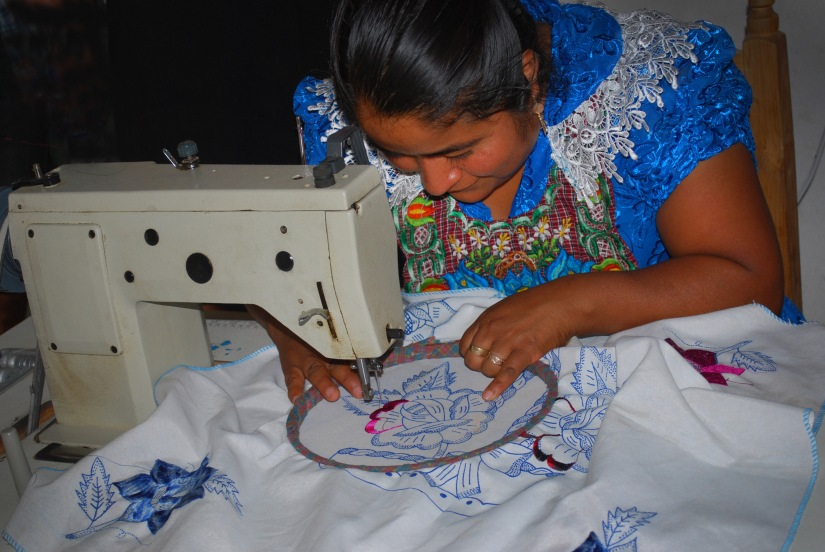 Martha provides a demonstration of her sewing capabilities to our group.