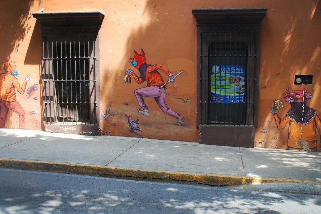 Detailed mural on Calle Crespo by Saner.