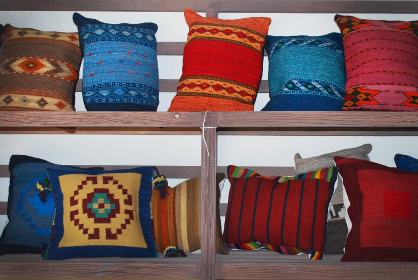 A range of wool cushions in brilliant hues.