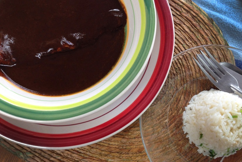 A plate of mole negro with chicken and rice from the organic market on Calle Rayon.