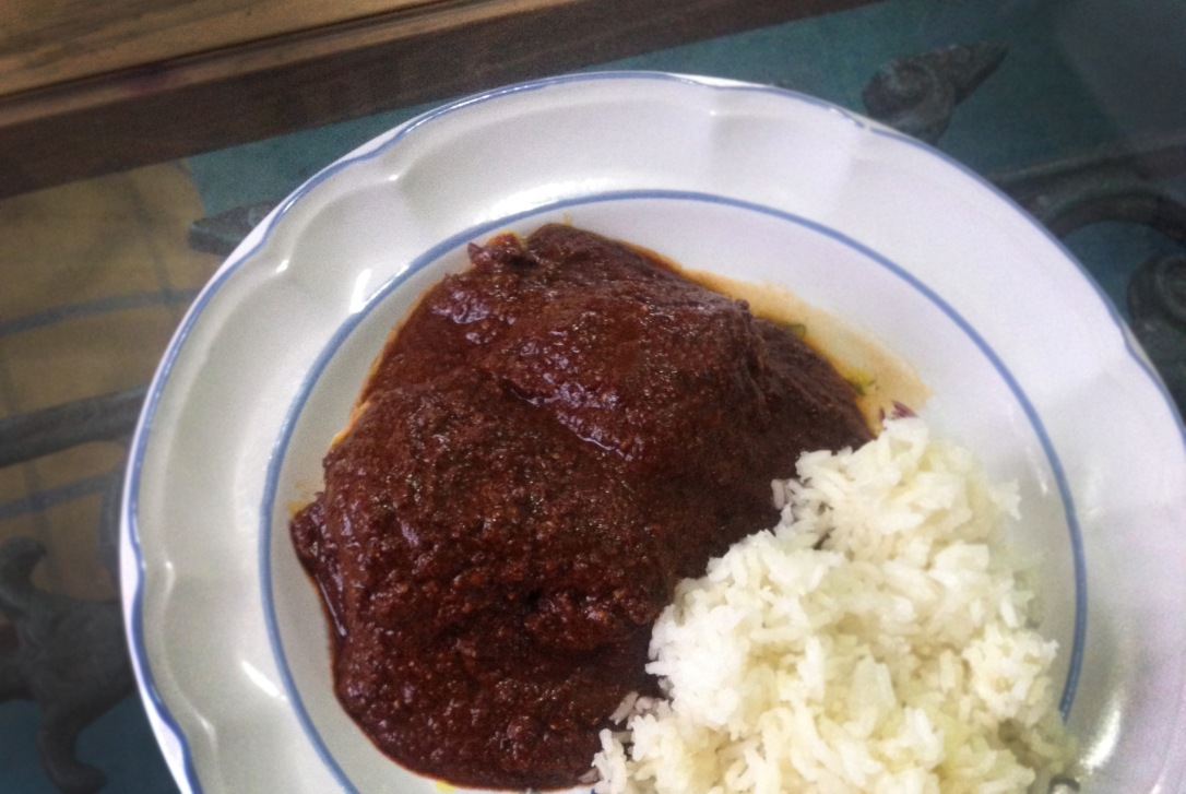 After three hours of preparation, we enjoy the fruits of our cooking labor with this hearty mole rojo.
