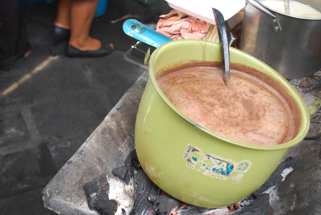 Oaxacan chocolate simmers over hot embers.
