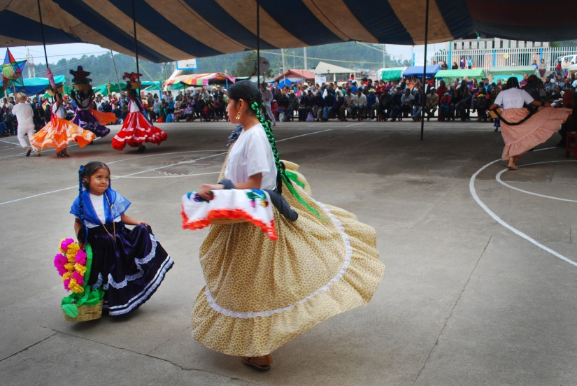 Local performers take part in traditional dances during the festivities.