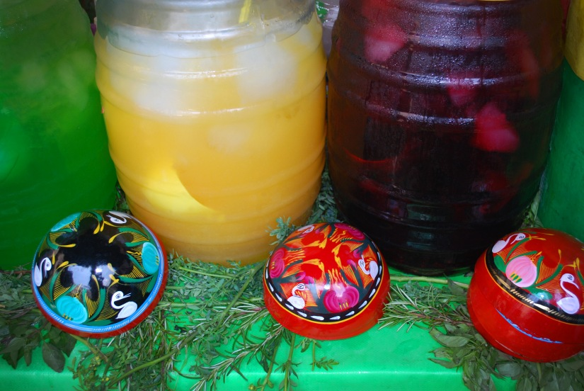 A selection of icy agua frescas at a vendor table in Oaxaca.