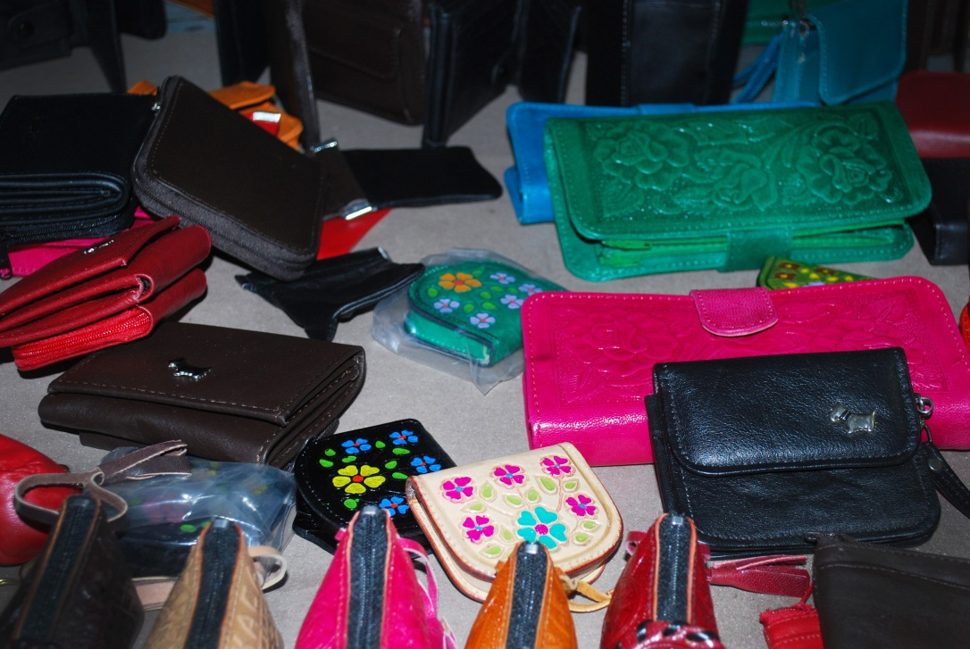 Embellished wallets and coin purses in the leather workshop.