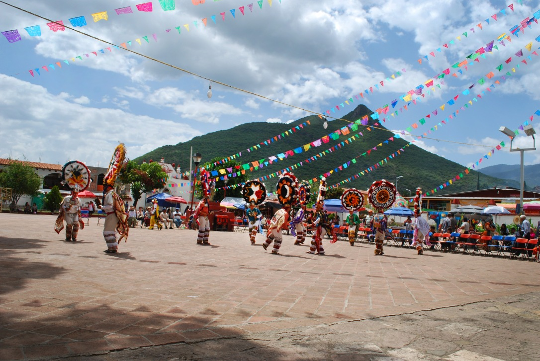 Dancers in front of the local mountain that oversees the pueblo.