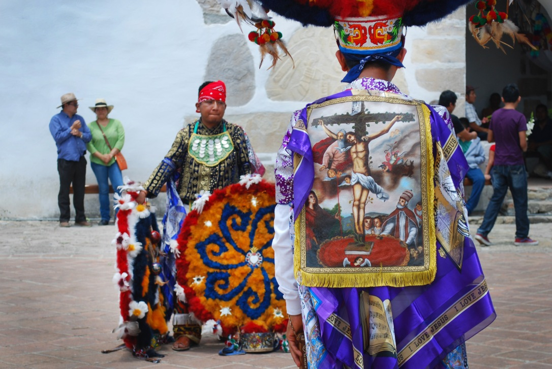 Danzantes prepare for the Danza de la Pluma.