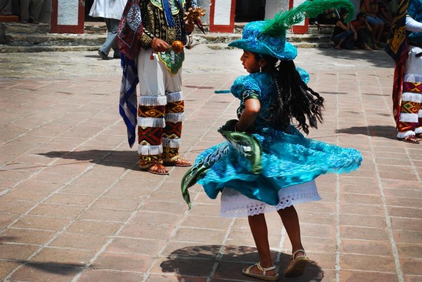 A little girl dances during the Danza de la Pluma performance in Teotitlán del Valle.