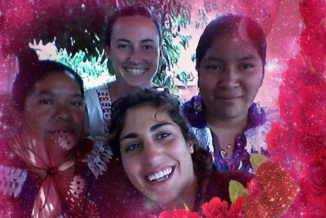 Embellished group shot with two community members in San Miguel del Valle.