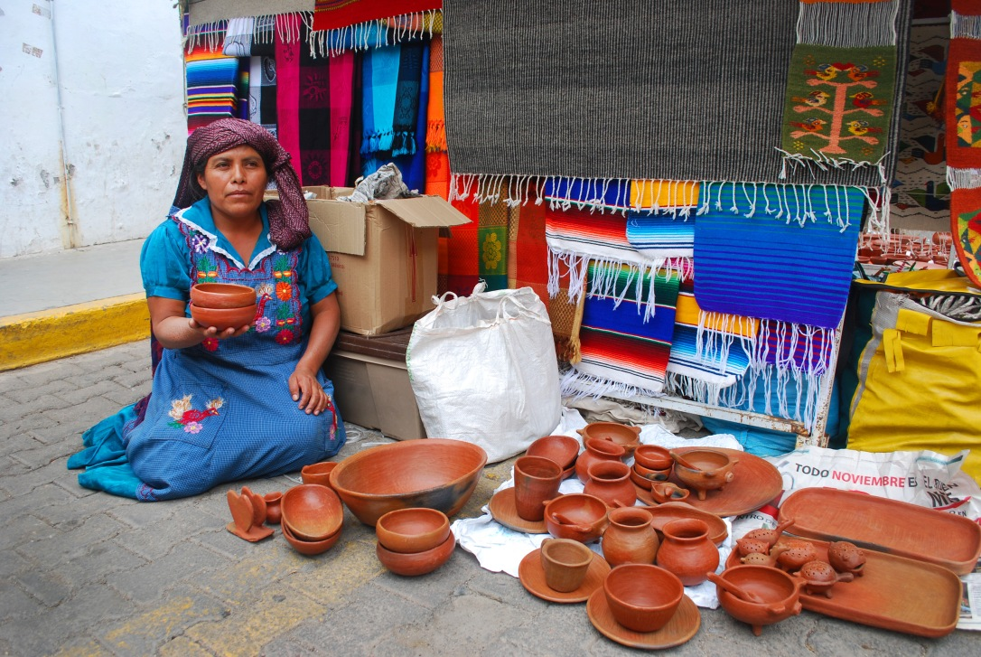 Maria with some of her barro rojo pottery pieces.