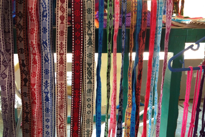 Finely woven belts in an artisan stall.