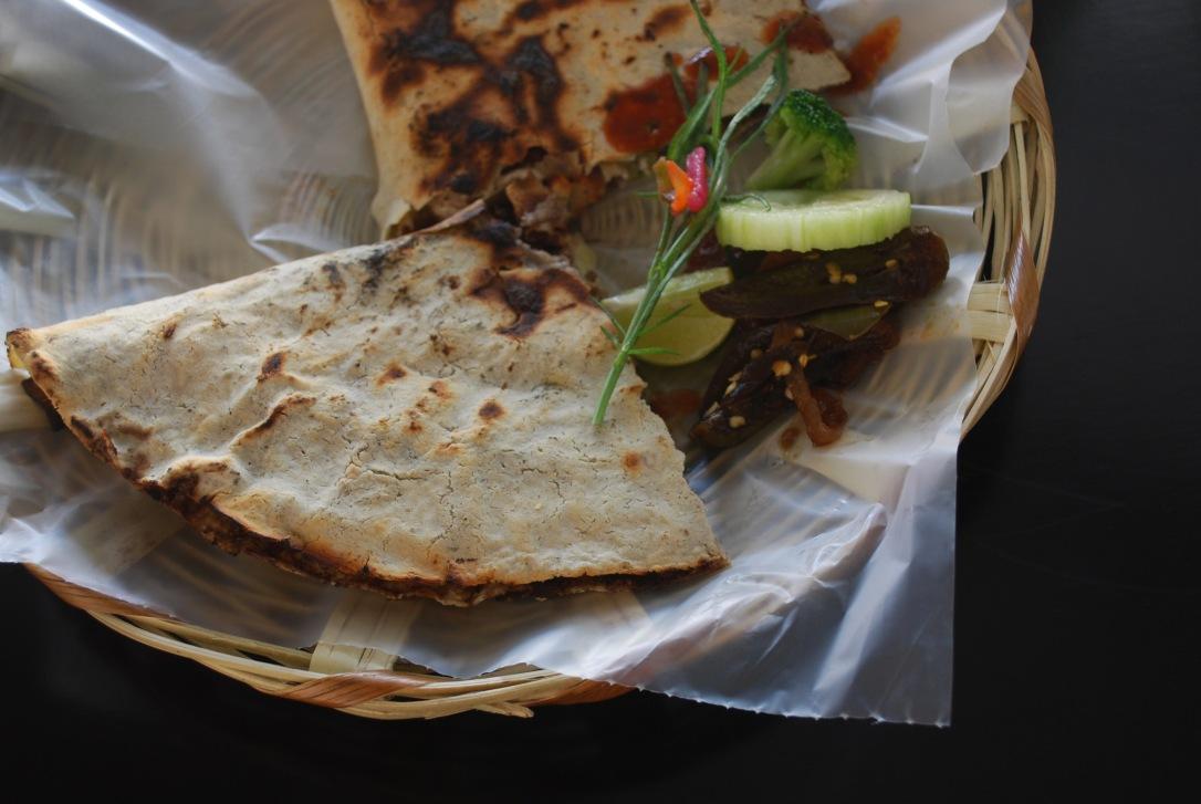 A mini tlayuda with tasajo (beef) at I Love Tlayudas in La Noria