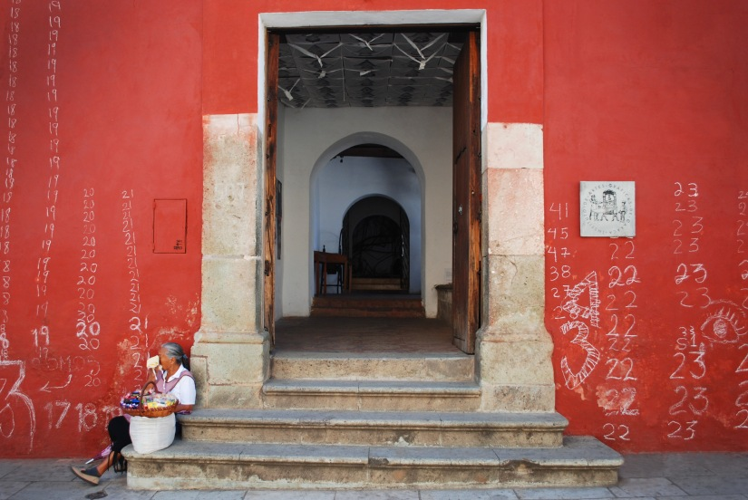 A local vendor rests outside of Instituto de Artes Gráficas de Oaxaca.