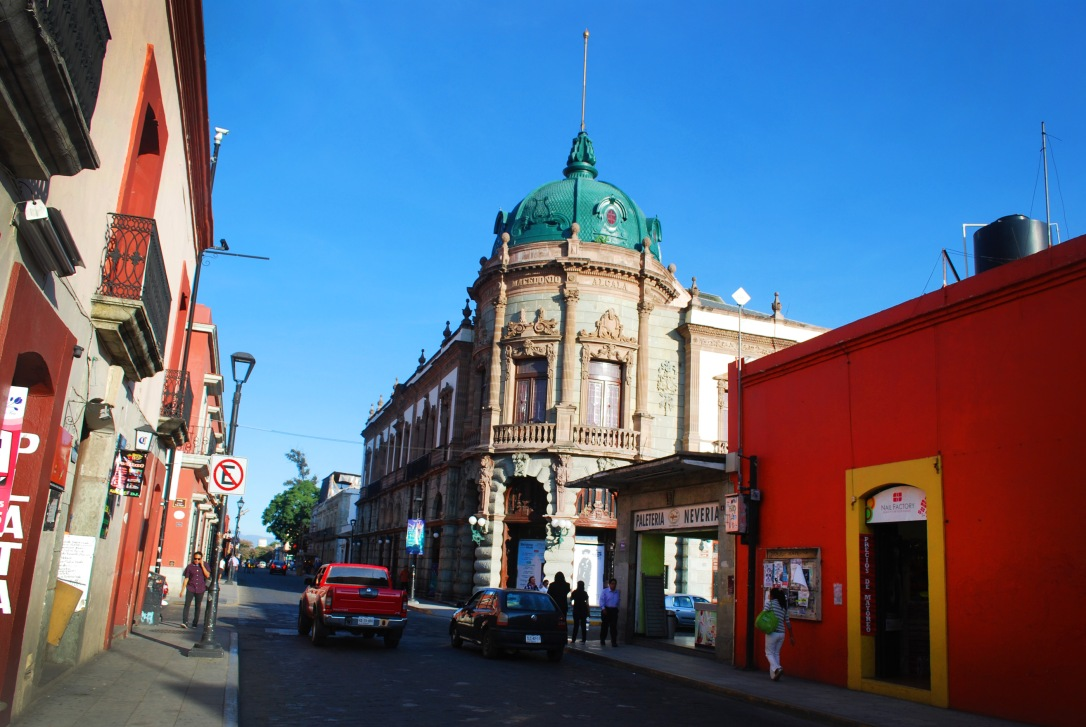A street view of the emerald-capped Teatro Macedonio Alcalá.