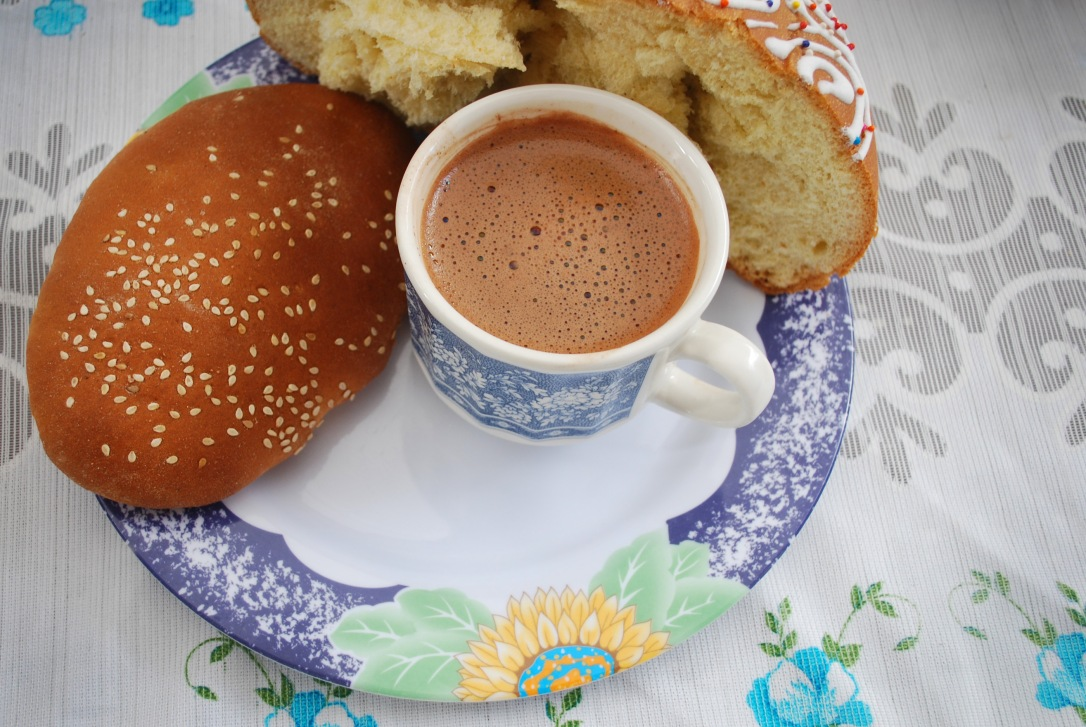 Hot Oaxacan chocolate and pan muertos at the table of the Méndez family in Mitla.