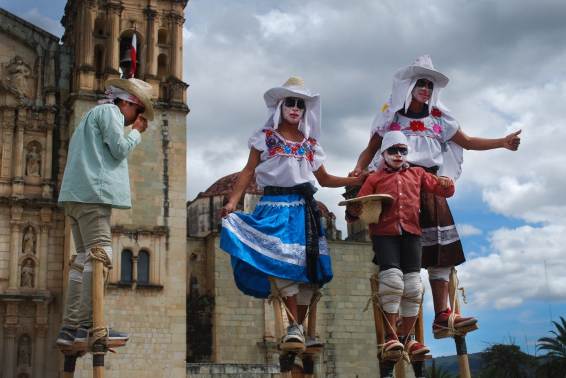 Stilt dancers seize the moment in front of Santo Domingo church.