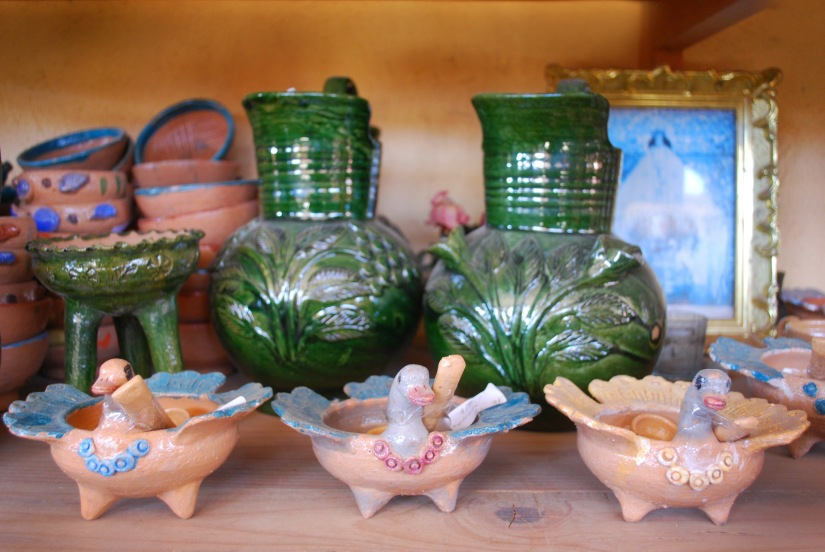 Irresistible ceramic duck salsa dishes guard green glazed water pitchers.