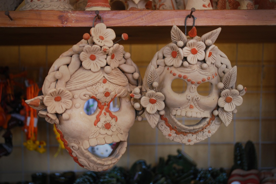 Hand formed and painted ceramic skulls pay tribute to the Dia de los Muertos tradition.